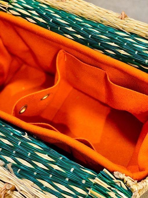 close up of burel lining CESTA reed project basket bright orange